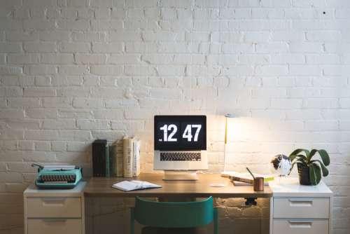 digital clock typewriter desk office
