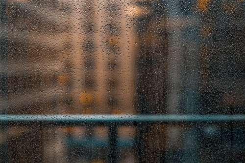 wet glass rain water drops