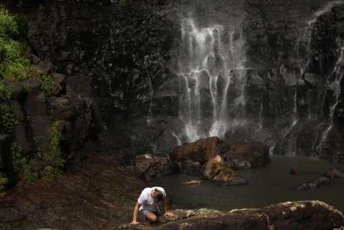 people man adventure outdoor waterfall