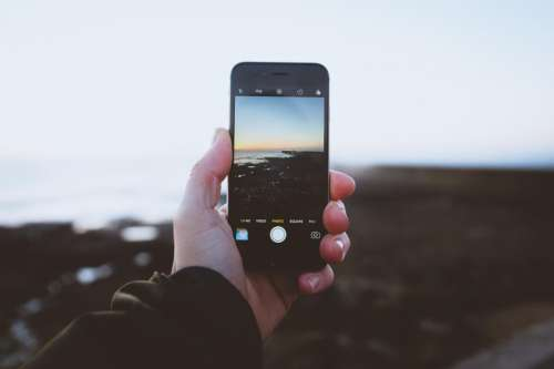 hand palm blur mobile phone