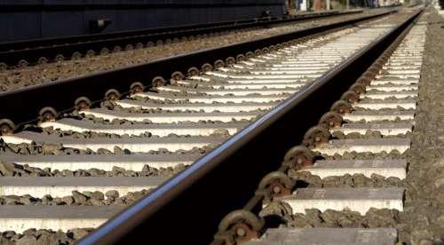 train railway track metal rock
