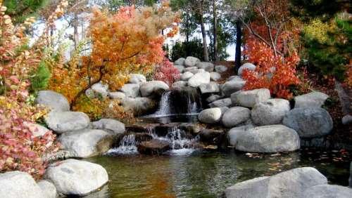 waterfall rocks water leaf fall