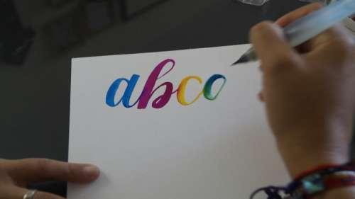 words lettering brush pen paper
