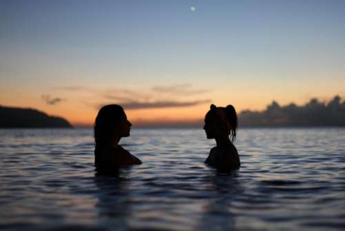 people girls women swimming friends