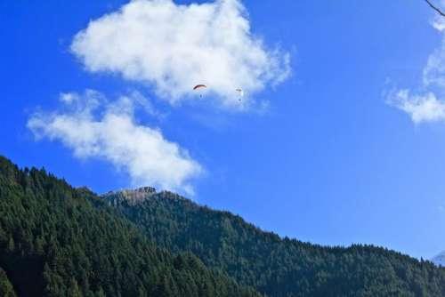 nature mountain trees sky parachute