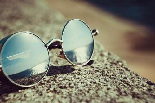 sunglasses reflection summer beach bokeh. blur