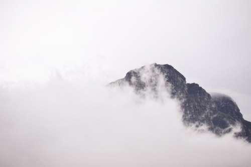 sky clouds fog mountains peaks