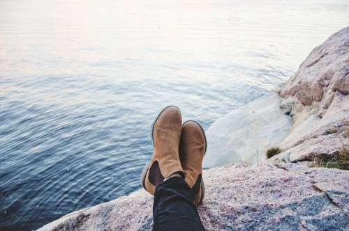 people boots water ocean sea
