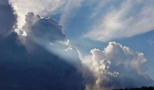 sky clouds sun rays blue nature