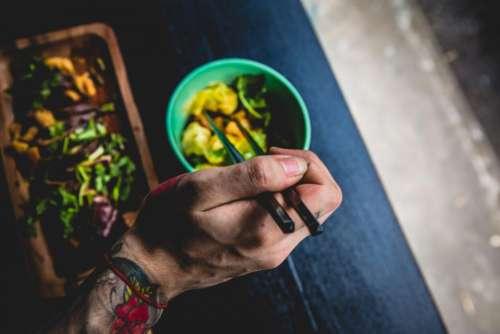 healthy food chopsticks bowl hands
