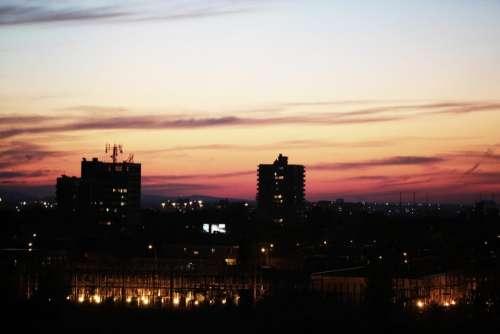 sunset sky night dark buildings