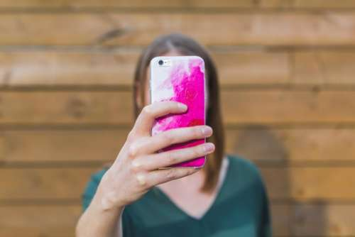 people woman phone hand camera