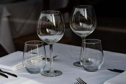 glass table white formal utensils