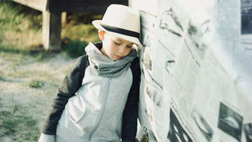 young child thinking pensive hat