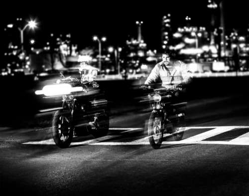 motor motorcycle black and white pedestrian race
