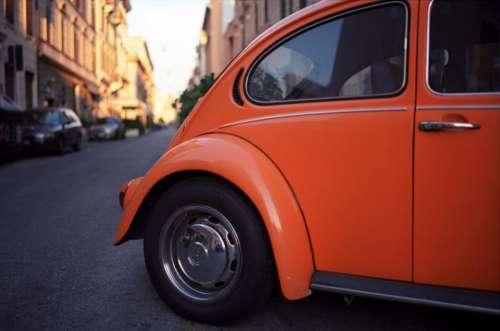 orange car auto vehicle travel