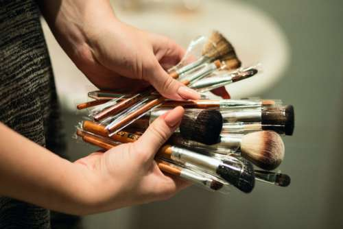 woman makeup brushes hands female