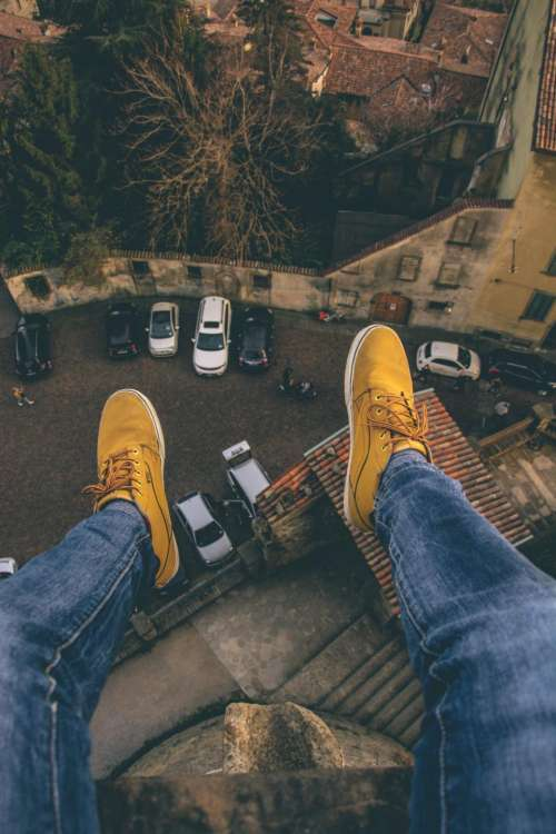 people shoe jeans rooftop car
