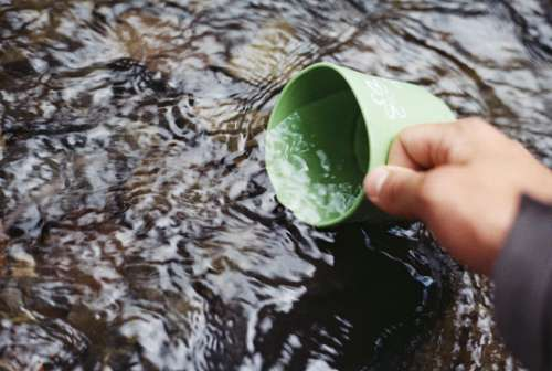 river water stream cup outdoors