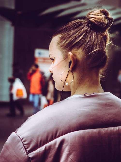 people woman earphone earrings hairstyle