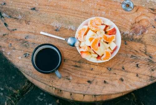 wood table outside food fruits