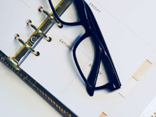 calendar diary glasses spectacles white background