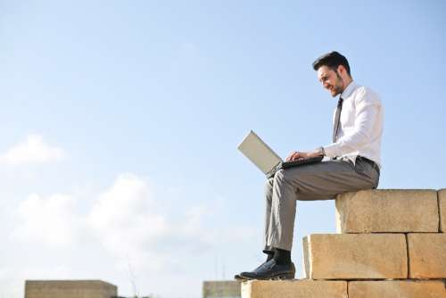 man laptop wall alone isolated