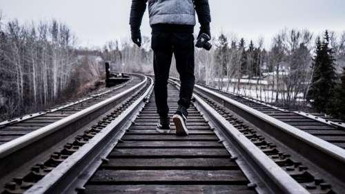 train tracks people photographer photography camera