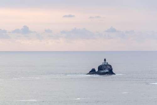 sea ocean water rocks hill