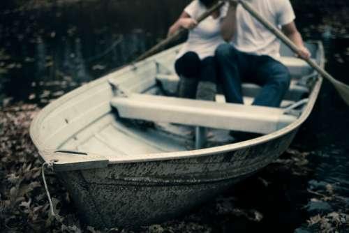 couple rowing boat woman girl