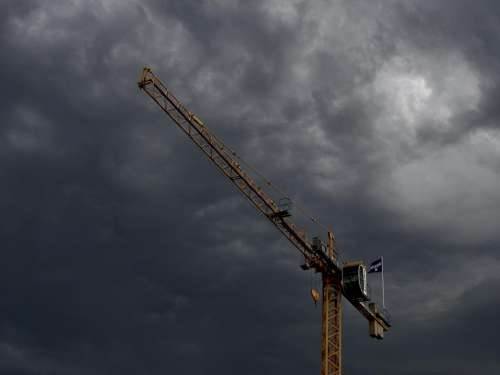 crane construction industrial sky storm