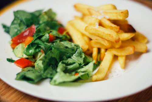 food salad french fries vegetables lunch