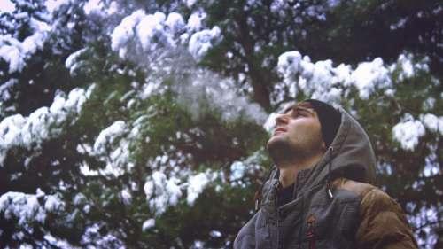 man guy snow hoodie cold