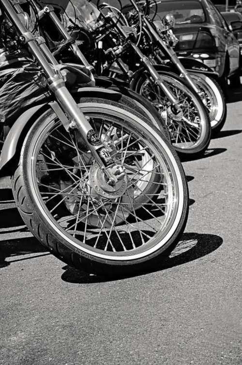 black & white row motorbikes transport travel