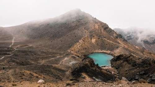 mountain landscape rocks fog sky