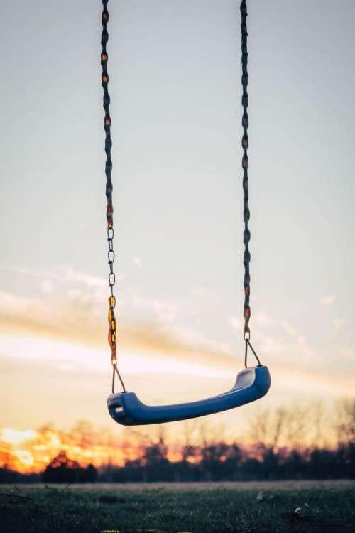playground swing sit chain sunset