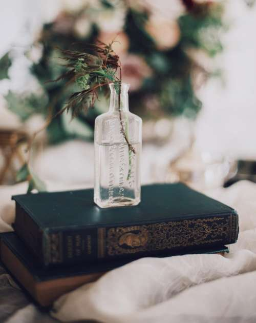 books cloth glass jar water