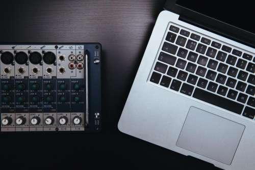 apple macbook laptop technology table