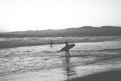 surfing surfer surfboard beach sand