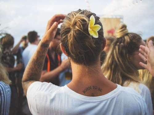 people crowd back tattoo arm