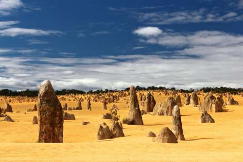 sand rock formation trees cloud