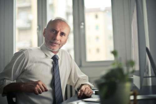 older businessman smiling work business