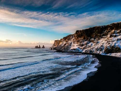 winter ocean cliffs snow cold
