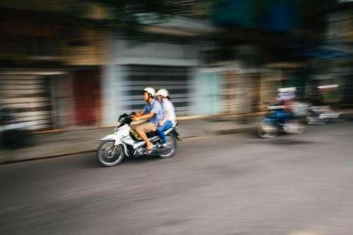 people woman man ride motorcycle