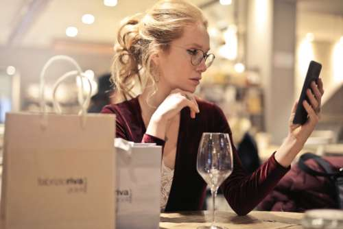 woman glasses mobile device technology