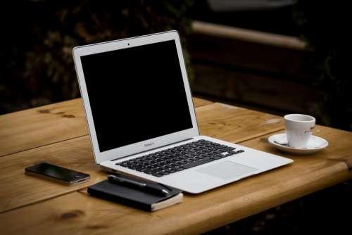 macbook air laptop computer notepad pen