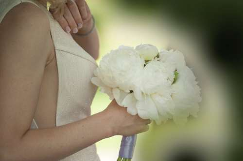 woman flowers wedding day dress