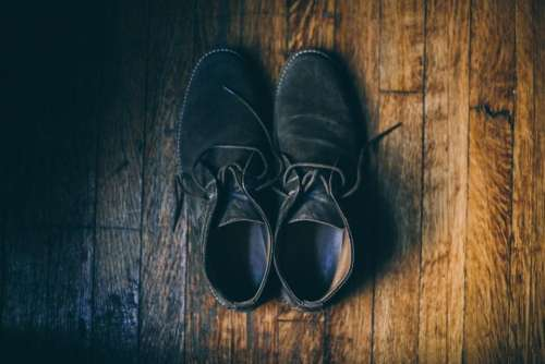 black shoe footwear wooden floor