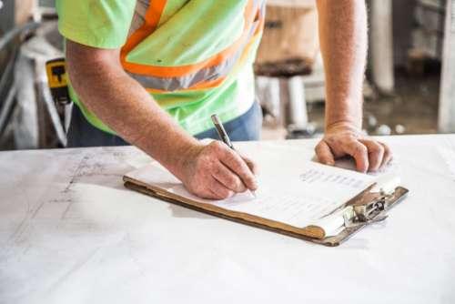 construction plans man person worker
