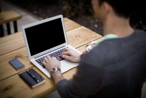 macbook air laptop computer typing working